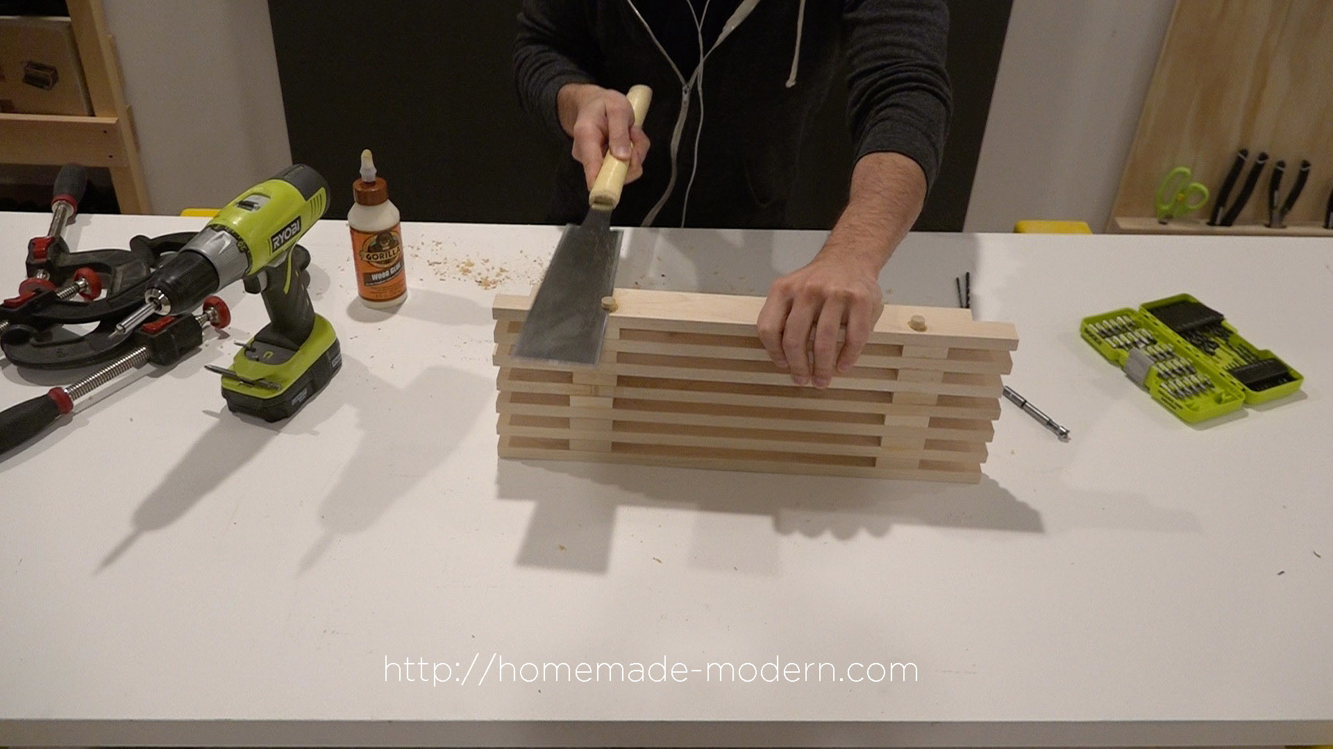 This DIY Dish Rack is designed to fit over a sink. Full instructions can be found at HomeMade-Modern.com