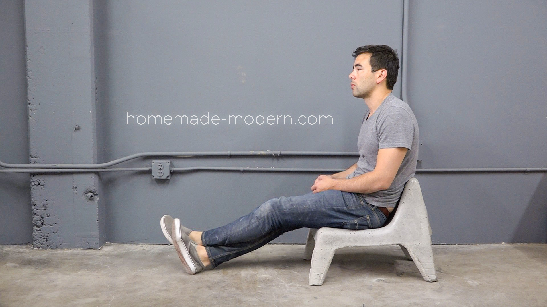 This DIY Concrete Chair was cast in a plastic chair from IKEA. For more information go to HomeMade-Modern.com