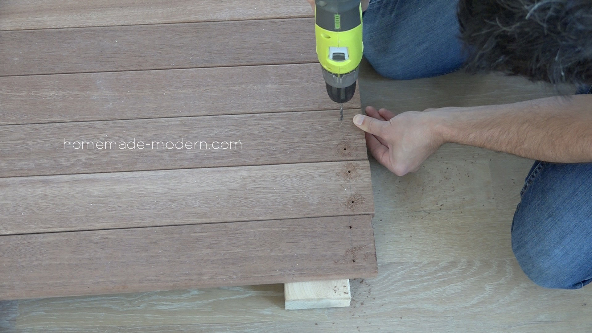 This DIY Outdoor Dining Table is made from painted 2x4s and hardwood deck boards. All the materials can be found at Home Depot. Full instructions can be found at HomeMade-Modern.com