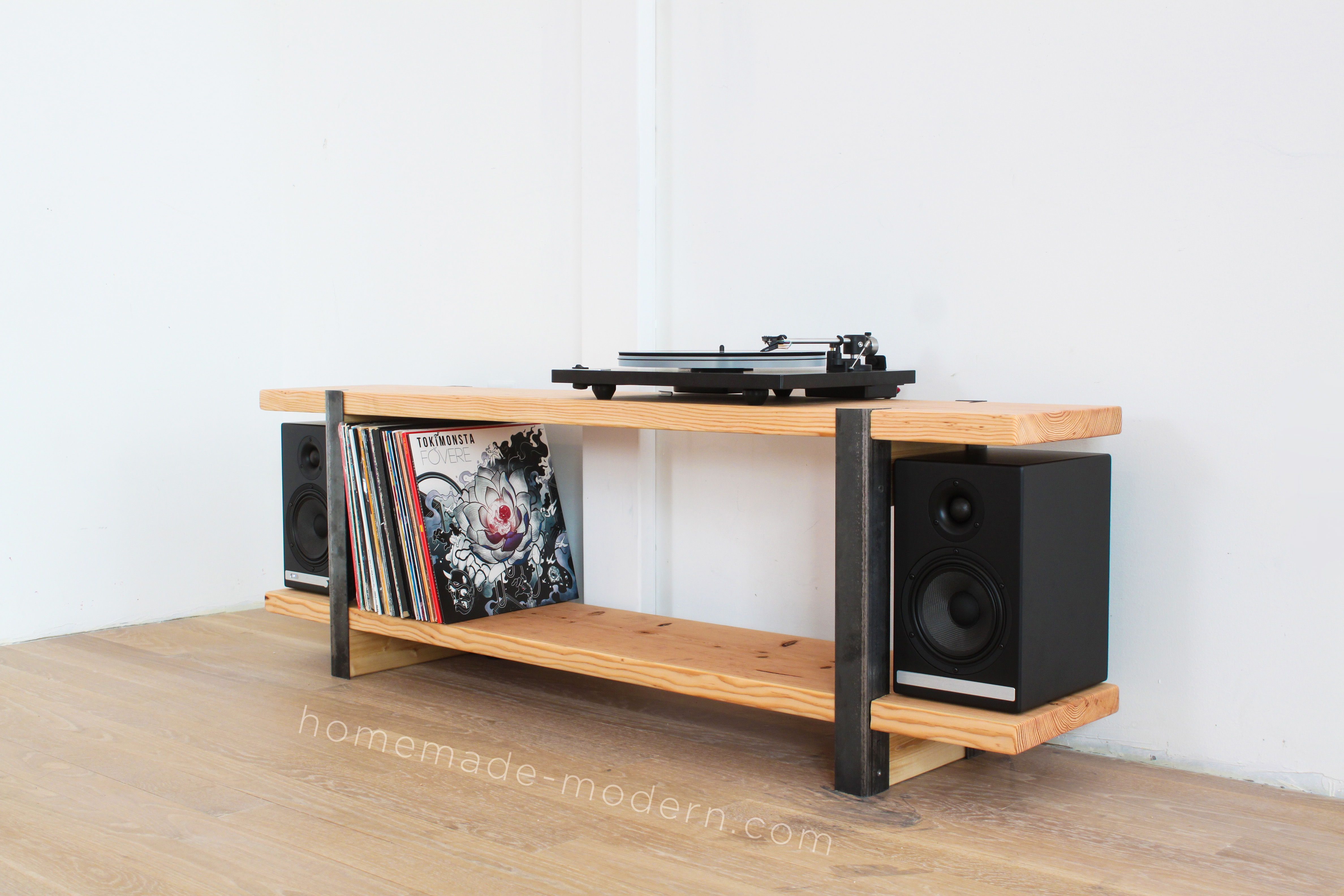 This DIY Media Console is made out of 2x12 and angle irons and the shelves were designed to store vinyl records. For more information go to HomeMade-Modern.com