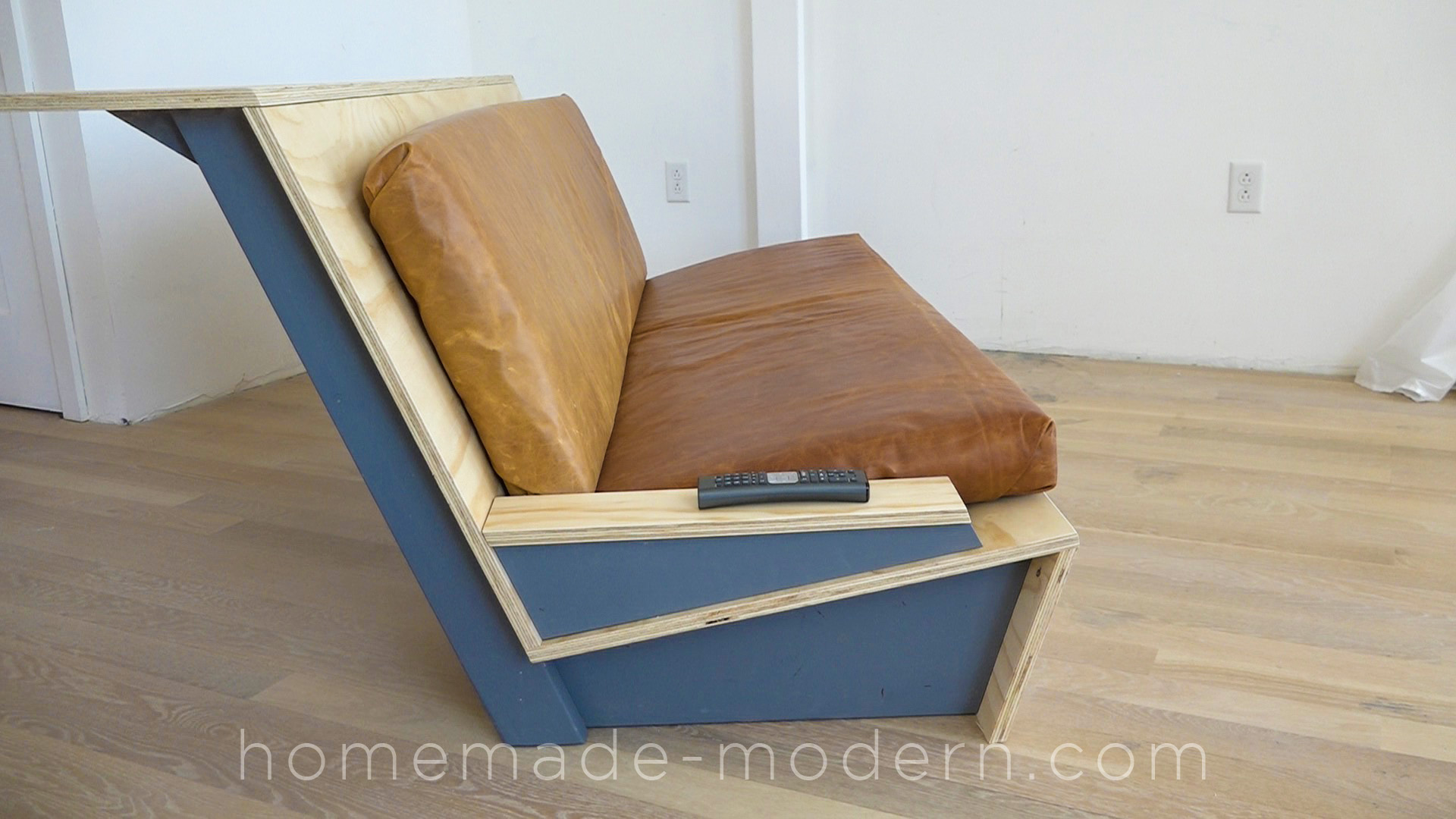 This DIY Zig Zag Sofa was designed specifically for lofts and has a built-in counter along the back. For more information go to HomeMade-Modern.com