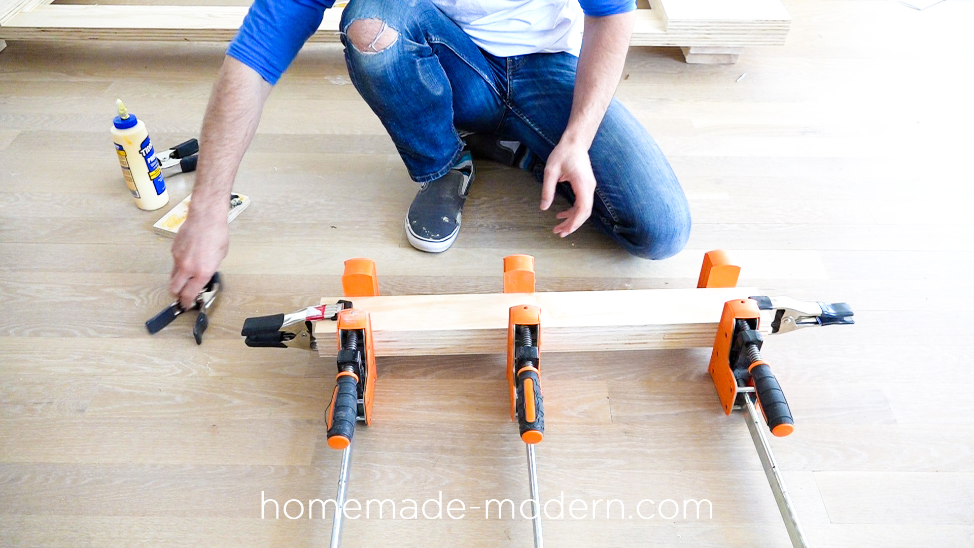 """This DIY modern plywood sofa is made out of 2-1/2"""" sheets of ¾"""" plywood from Home Depot. Full instructions can be found at HomeMade-Modern.com"""