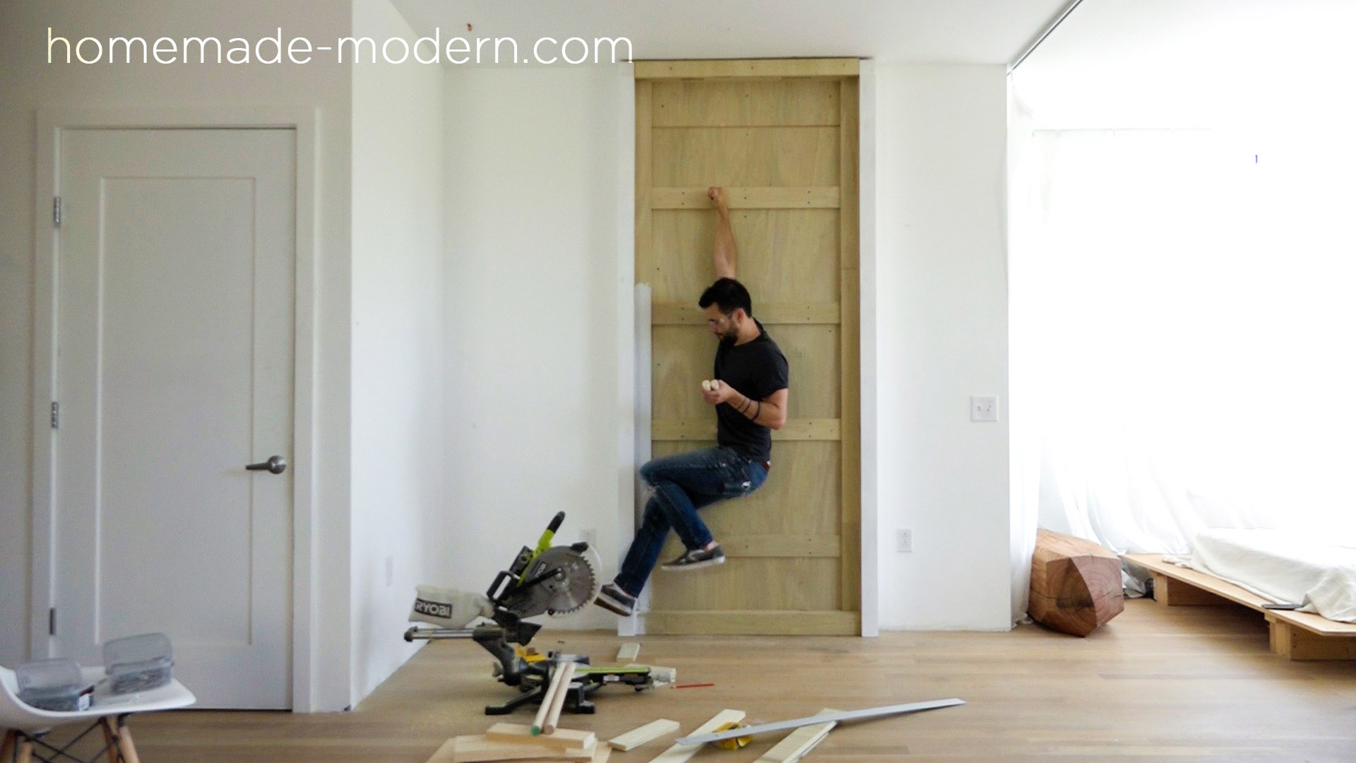 This fold-out gym is perfect for crossfit style exercise routines at home and is made from plywood. Full instructions can be found at HomeMade-Modern.com