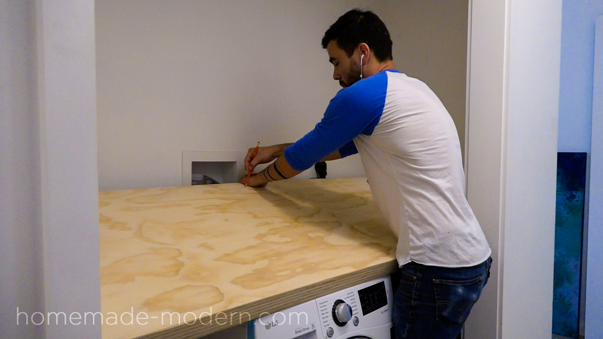"The shelving for this DIY Laundry Room was made out ¾"" plywood from Home Depot. Everything was designed it so that it only requires a circular saw, a drill and less than $150 worth of materials. Full instructions can be found at HomeMade-modern.com"