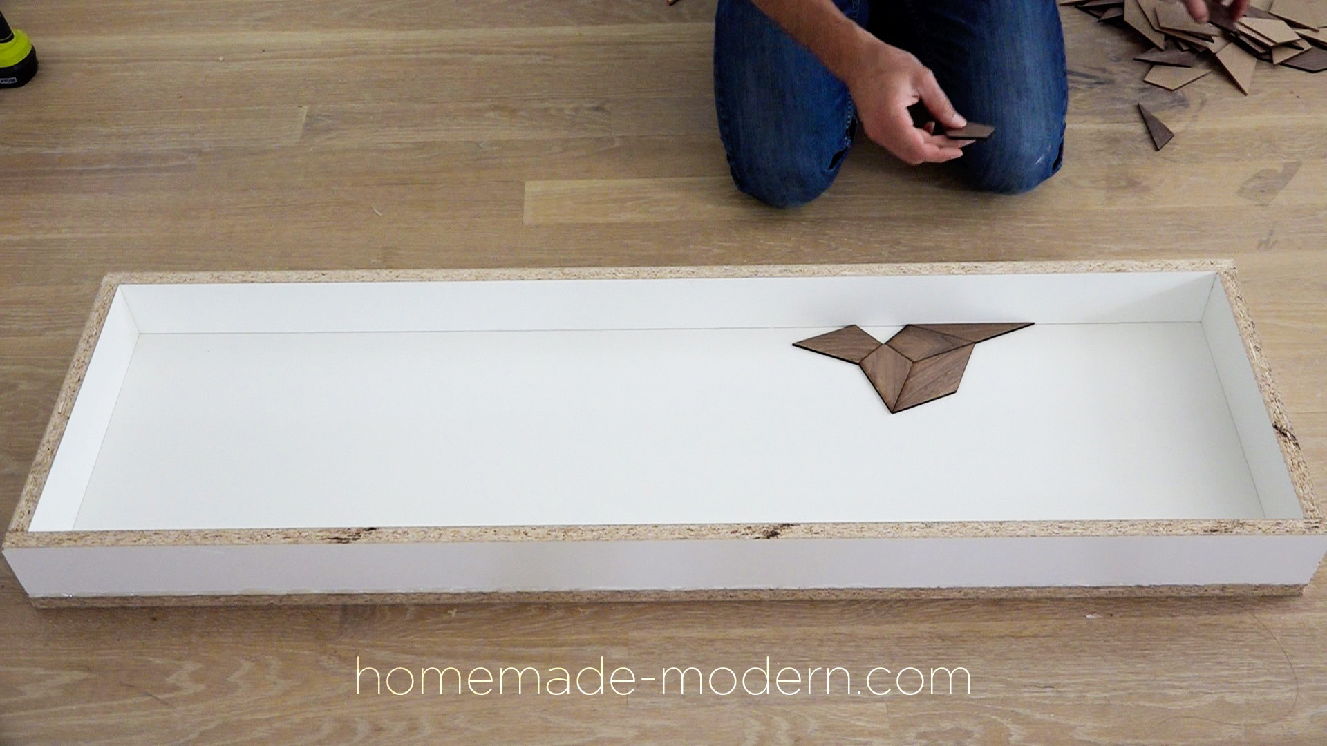 This white concrete table has a laser cut walnut inlay and was designed by Ben Uyeda. For more information go to HomeMade-Modern.com