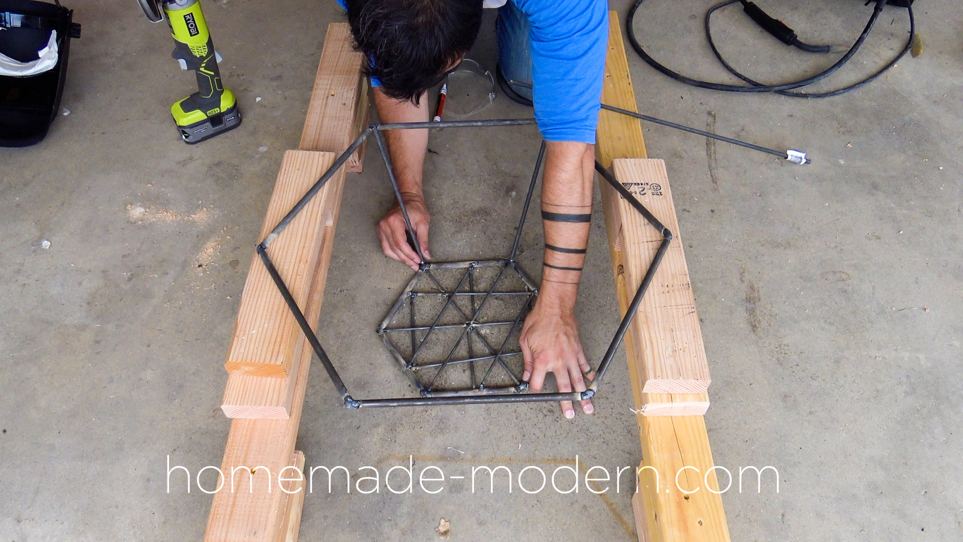 This DIY modern steel fire pit designed by Ben Uyeda is made out of steel rods from Home Depot that are welded together. For more information go to HomeMade-Modern.com