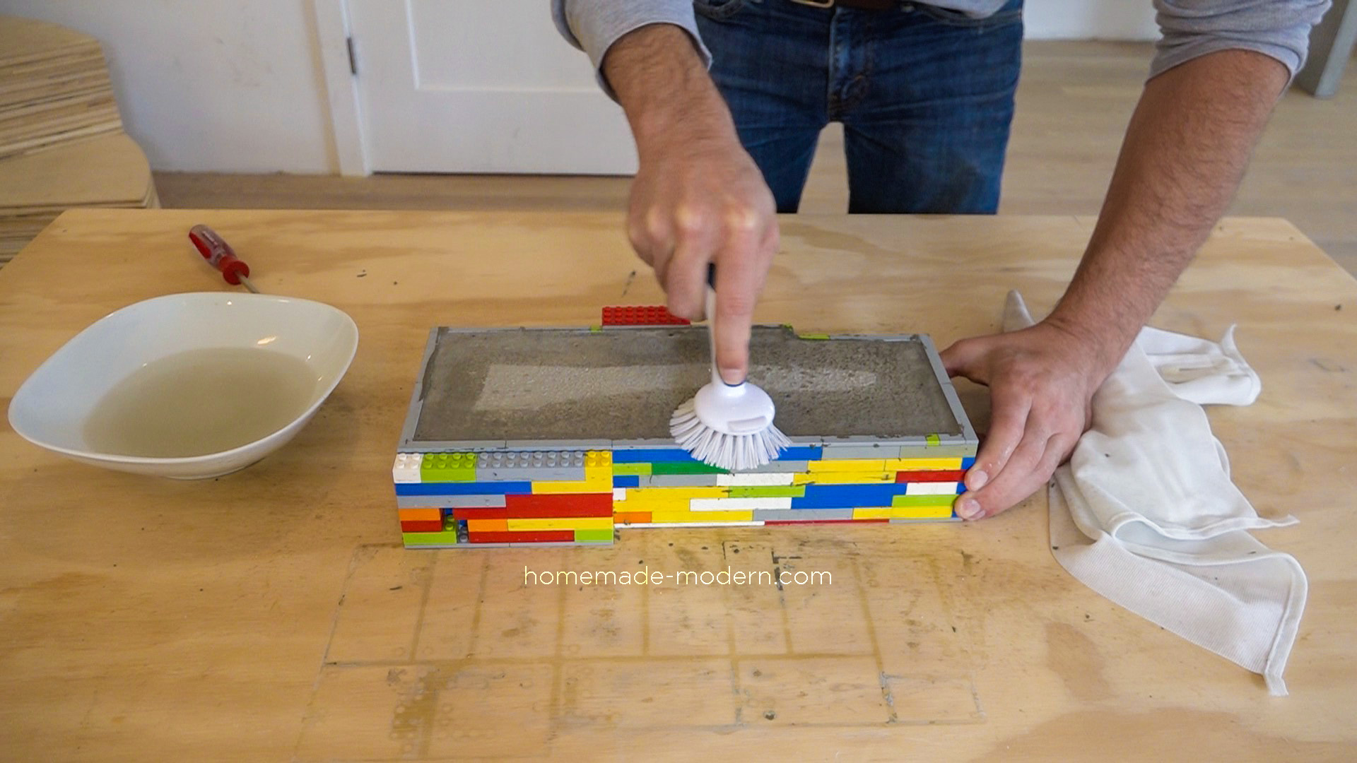 This DIY concrete backsplash was made using Lego bricks to form concrete. The Lego bricks were not damaged during this process. For more information on this project and on DIY concrete countertops go to HomeMade-Modern.com