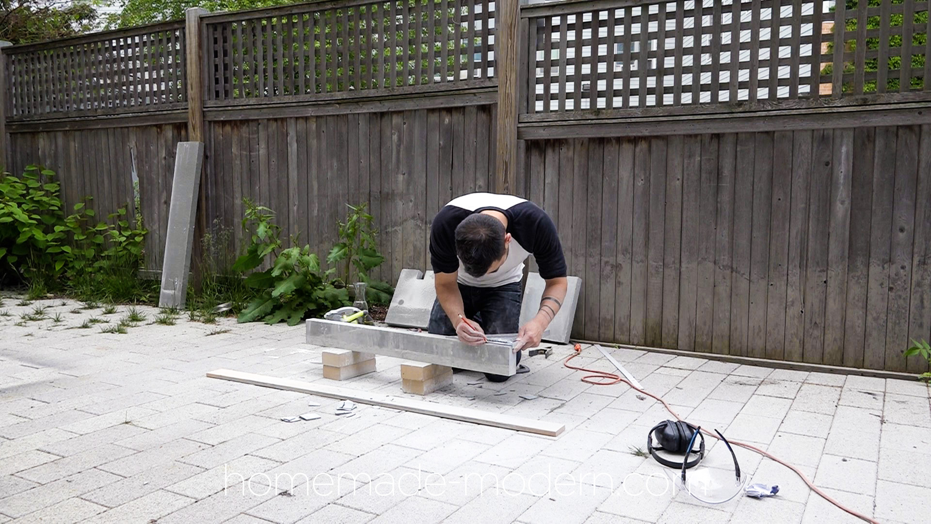 "This DIY stone bench was made out of 2"" thick slabs of bluestone that was cut with a standard circular saw. For more information go to HomeMade-Modern.com"