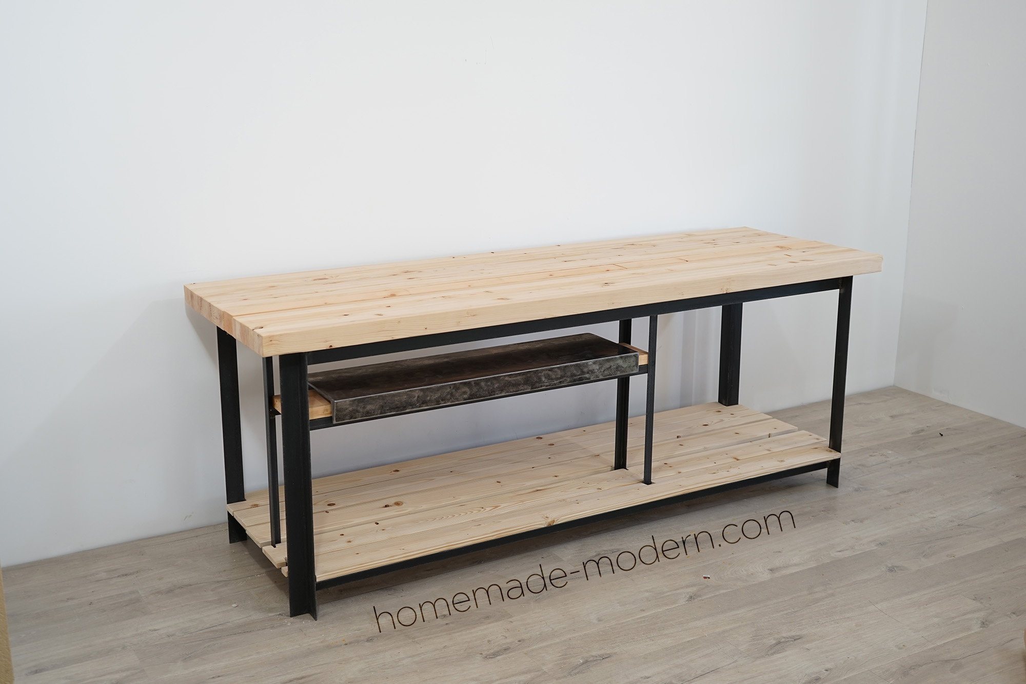 Ben Uyeda of HomeMade Modern designed and built this split top workbench with a removable steel top. For more information go to HomeMade-Modern.com