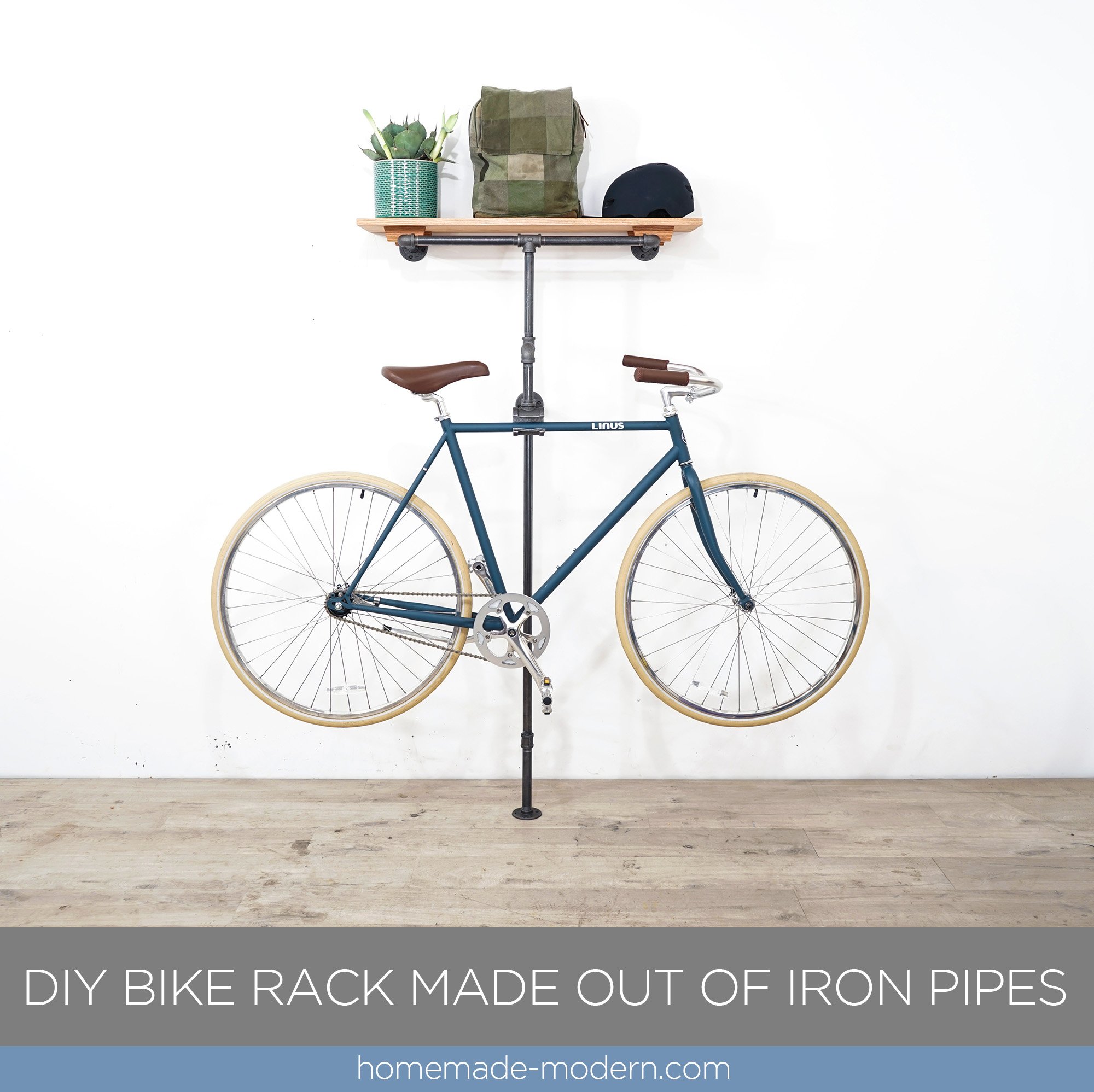 "This DIY Bike Rack is made out of black iron plumbing pipes. The structure is made out of ¾"" pipes screwed together and the bike hanger is made by cutting a large pipe fitting and then gluing in a piece of felt with Krazy Glue Gel. For more information on this project and other modern DIY projects go to HomeMade-Modern.com"